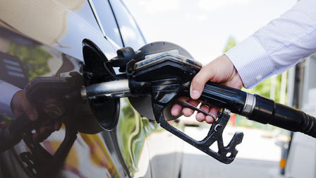Man-s-hand-refueling-car-petrol-station_23-2147841949_thumb_main